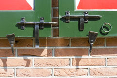 Close-up shot of a latches on wooden Dutch doors Stock Photos