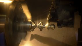 Close-up shot of lathe in operation cutting and processing of metal part stock footage