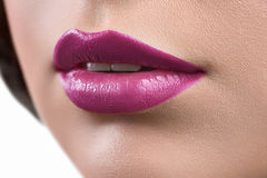Close up shot of the lips of a woman wearing lipstick or lip glo Royalty Free Stock Photography