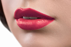 Close up shot of the lips of a woman wearing lipstick or lip glo Royalty Free Stock Images
