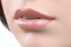 Close up shot of the lips of a woman wearing lipstick or lip glo Stock Images