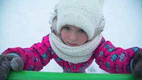The Girl on the Playground in Winter. Close-Up Shot of Little Girl Playing on the Playground in Siberian Winter Time stock footage