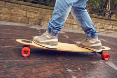 Close up shot longboarder in action Royalty Free Stock Images