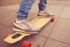 Close up shot longboarder in action Royalty Free Stock Photos
