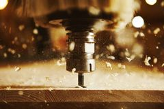 Close-up shot of machine with numerical control cuts wood. Cnc tool. Woodworking industry stock photo