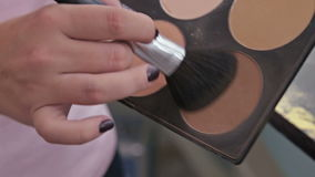 Close up shot. Make-up artist taking blusher from makeup palette stock video footage
