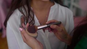 Close up shot of make up artist taking powder by brush stock video footage