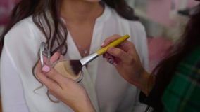 Close up shot of make up artist taking powder by brush stock footage