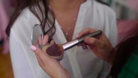 Close up shot of make-up artist taking powder by brush stock video footage