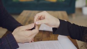 Close-up shot of male hand signing buy and sell contract and getting house keys from housing agent then shaking hands. Selling and buying real estate and stock footage
