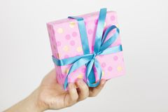 Close up shot of male hands holding a small gift. Small gift in the hands of a man.Shallow depth of field with focus on the little. Box.Selective focus royalty free stock photos