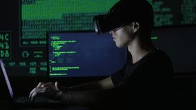 Male hacker programmer uses a virtual reality helmet for programming. IT Technologies of the Future. stock video footage