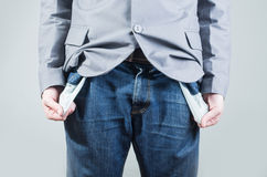 Close up shot of man holding out his empty pockets Royalty Free Stock Photography