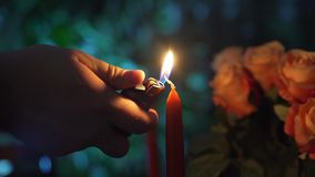 Close up shot of a man that lights candles. Valentines day. making a marriage proposal. stock footage