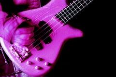 Pink guitar. Close up shot of man playing pink guitar Stock Photo
