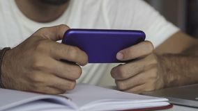Close up shot of man`s hands playing game on smartphone. Mobile phone stock footage