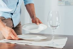 close-up shot of man serving table stock image