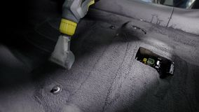 Close up shot of a man using powerful water vacuum cleaner for floor. Close up shot of a man using powerful vacuum cleaner for floor. Car cleaning services. Wet stock video