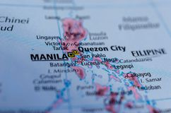 Manila on map. Close up shot of Manila. Filipino: Maynilà. is the capital of the Philippines and the most densely populated city proper in the world Royalty Free Stock Photo