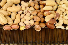 Close up shot of many nuts from above on brown mat Royalty Free Stock Images