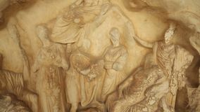 Close-up shot of marble relief depicting god Pan and Nymphs, Greek mythology. Stock footage stock video footage