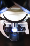 Close up shot of microscope at the blood laboratory Royalty Free Stock Photos