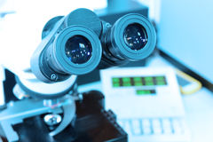 Close up shot of microscope at the blood laboratory Royalty Free Stock Images
