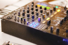 Close up shot of a mixer desk with many buttons.  Royalty Free Stock Photo