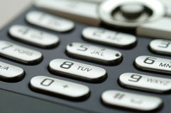 Close up shot of mobile keypad under light Stock Images