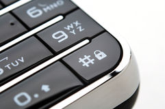 Close up shot of mobile keypad under light Stock Photos