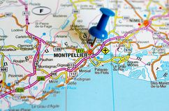 Montpellier on map. Close up shot of Montpellier on map with blue push pin royalty free stock photo