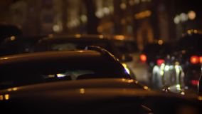 Close-up shot of moving cars in night city on blurred lights background. stock video