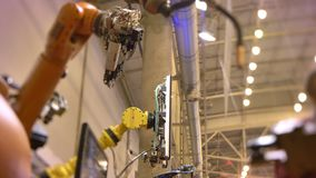 Close-up shot of moving piped automatic robotic arm in process on exhibition background. stock video footage