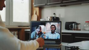 Close-up shot of Multiracial colleagues working home on quarantine by making common video call by computer