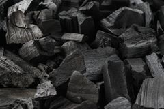 Close-up shot of natural charcoal. Black background. Close-up shot of natural charcoal. Black texture background royalty free stock photography