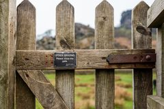 Free Close Up Shot Of A Closed Gate That Stops Sheep Passing Through That Says Stock Grazing On The Front Royalty Free Stock Images - 154351269