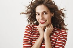 Close-up Shot Of Sensual Feminine Woman In Red Lipstick And Striped Sweater, Standing In Tender And Cute Pose, Holding Stock Photography