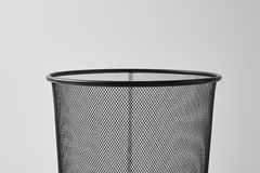 Close-up shot of office trash can isolated. On white stock photography