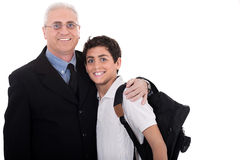 Close up shot of old business man embraces. A teenager on isolated background Royalty Free Stock Image