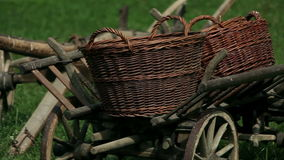Close up shot of the old wooden cart with the big baskets on it stock video footage