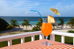 Close-up shot of the orange drink on the beach, sea and sky back. Ground Royalty Free Stock Photography