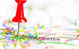 Close-up shot over Manchester City On Map, United Kingdom. Red pushpin showing Manchester City On Map, United Kingdom, Travel Destination Concept Royalty Free Stock Images
