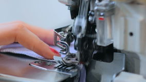 Close up shot of overlock sewing machine stock video footage