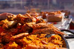 Close up shot of paella prawns and rice at market royalty free stock photography