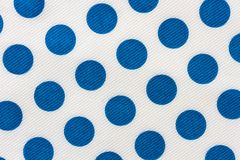 Paper napkin. Close-up shot of a paper napkin with blue polka-dots Stock Photos