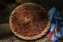 Close up shot of a pecan pie cooling. American classic homemade pecan pie. Amish pies. Napkin a flag of USA. stock photos