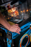 Close up shot of person playing with a pinball machine Stock Image