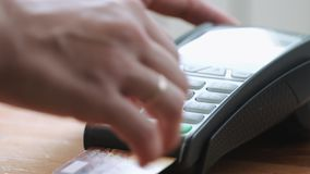 Person using credit card. Close-up shot of person using credit card for mobile payment stock video