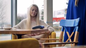 Person using mobile payment PayPass. Close-up shot of person using mobile payment PayPass stock video footage