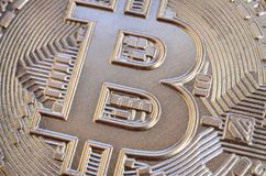Close up shot of a physical bitcoin with a shiny relief surface stock image